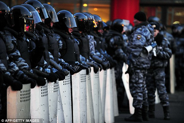 Riot police officers cordoned off the area of an opposition rally at Pushkinskaya Square in central Moscow on Monday