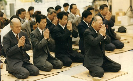 All together now: Japanese men praying