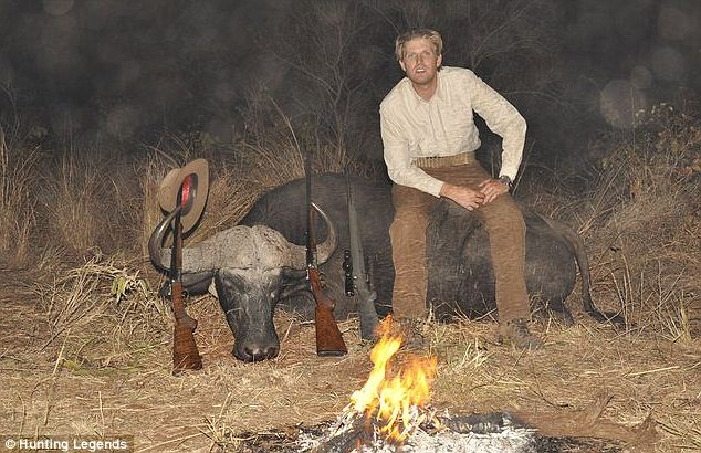 Posing with their prey: Eric sits atop one of their kills. In his responses to critics on Twitter, Don said that the animals were used as meat for hungry villagers who do not eat the animals often