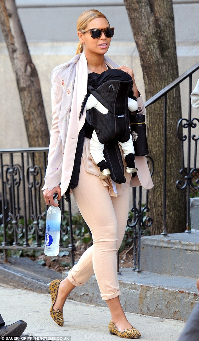 New look: Beyonce has sensibly ditched her super-high heels as she enjoys her first few months as a new mother
