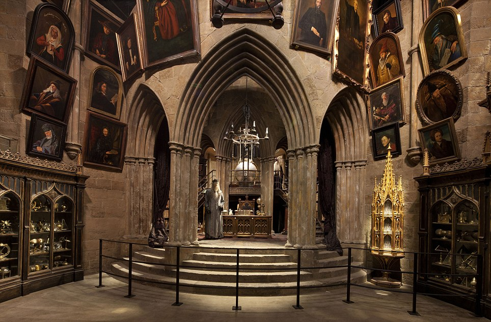 A Dumbledore figure stands beneath an arch surrounded by portraits in Hogwarts