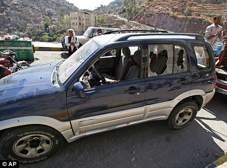 Shrum was shot by two gunmen on a motorcycle in his car, pictured, shot dead on Sunday as he drove to the language institute in the city of Taiz