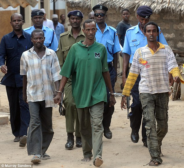 Ali Babitu Kololo, front centre in green, after appearing in Lamu court concerning the killing of MrTebbutt and abduction of Mrs Tebbutt