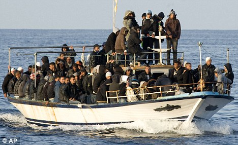 A boat loaded with migrants is spotted at sea off the Sicilian island of Lampedusa in March last year