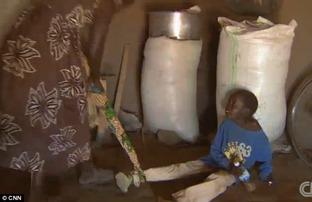 Grace Lagat, from northern Uganda, is forced to tie her two children up whenever she leaves her home to stop them wandering off