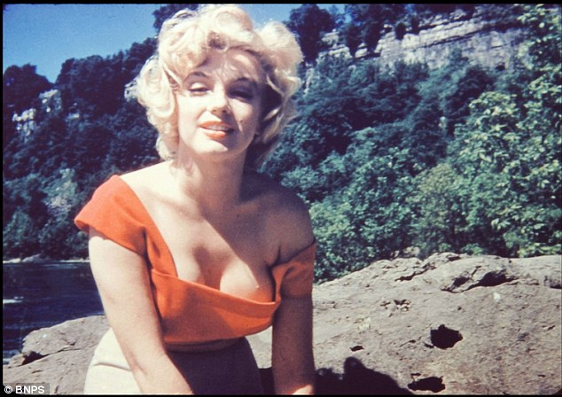 Intimate: Trusted make-up artists Allan 'Whitey' Snyder took these charming shots of a 27-year-old Marilyn Monroe relaxing between takes