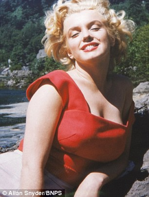 Stunning: The unseen photographs show a carefree Marilyn Monroe soaking up the sun on a beach between film takes