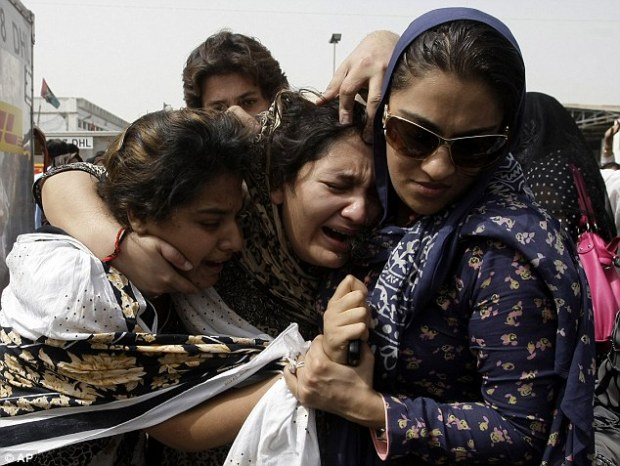 Grief: Family members of Fakhra Younus cannot hide their anguish at Karachi airport as the acid attack victim's body was returned to Pakistan