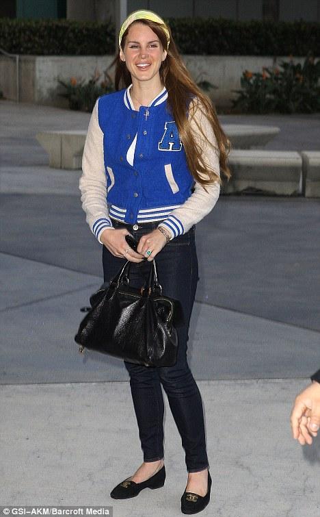 Lana Del Rey Wears Cute Varsity Jacket At LA Lakers Game