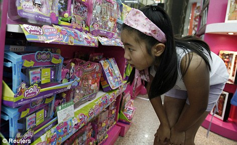 Shopping mania: It may not be bad news for British companies as they will hope to be able to cash in on China¿s massive new spending power