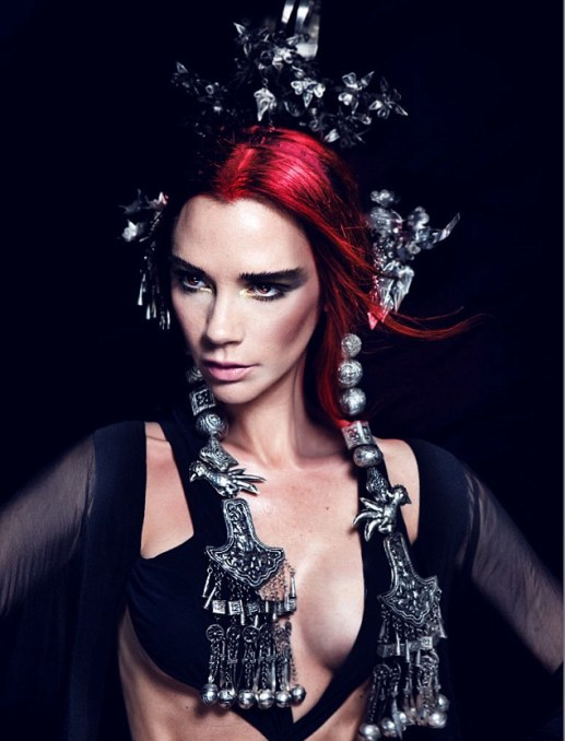 Different look: Victoria Beckham becomes a redhead for a striking new look as she poses for Harper's Bazaar China