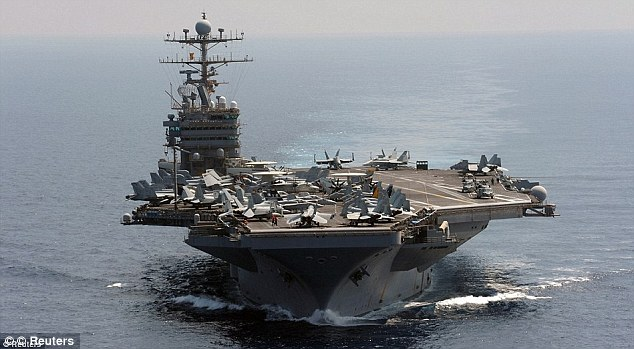 Joining forces: The Abraham Lincoln carrier (pictured) will now be joined by the Enterprise carrier in the Persian Gulf