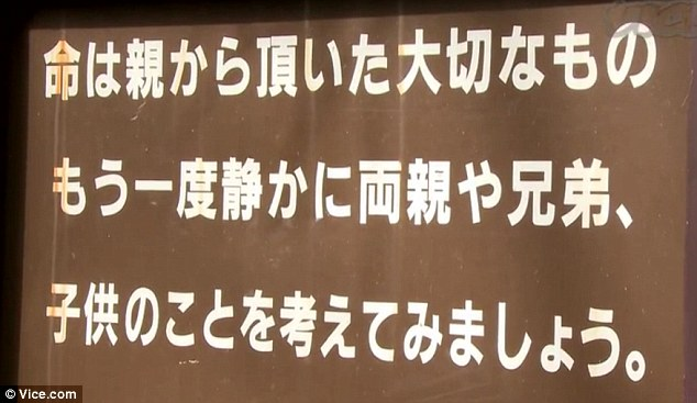 Plea: A sign at the entrance to the forest urges suicidal visitors to think of their families