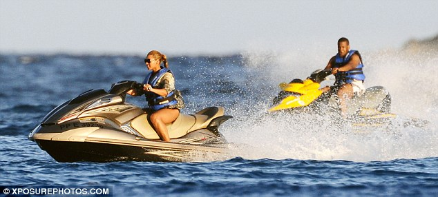 Catch me if you can: Jay-Z looked content to follow his wife around on the jet skis
