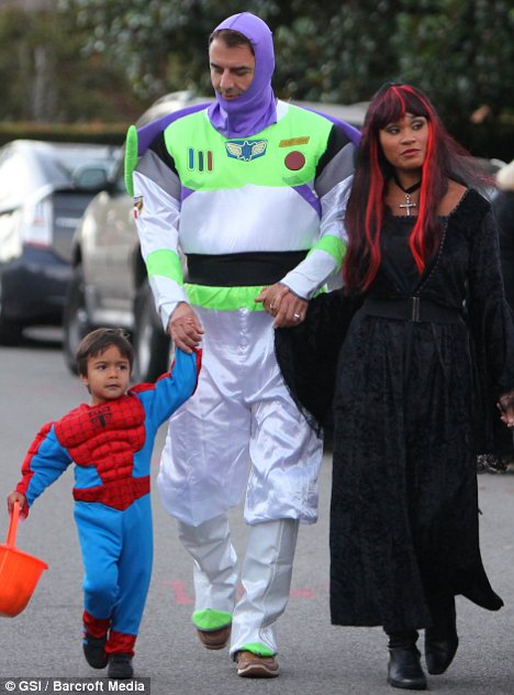 A family affair: The couple's four-year-old son Orion, pictured with his parents on Halloween 2010, served as the ringbearer for the nuptials