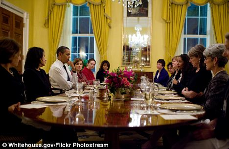 Troubled talk: In September of last year, a number of female White House employees had dinner with Mr Obama to talk about their overlooked opinions