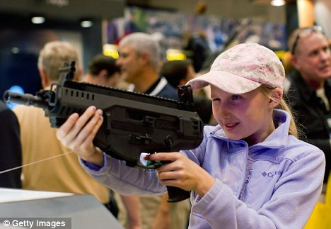Starting young: 12-year-old Bailey Chappuis checks out a Beretta ARX 160