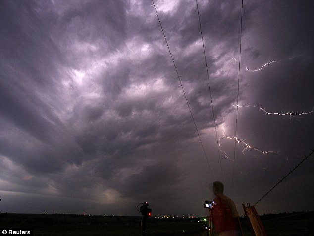 Storm chaser: Photographer Brad Mack from Orange County, California, takes photos of lightning from a tornadic super cell near Apache City Oklahoma