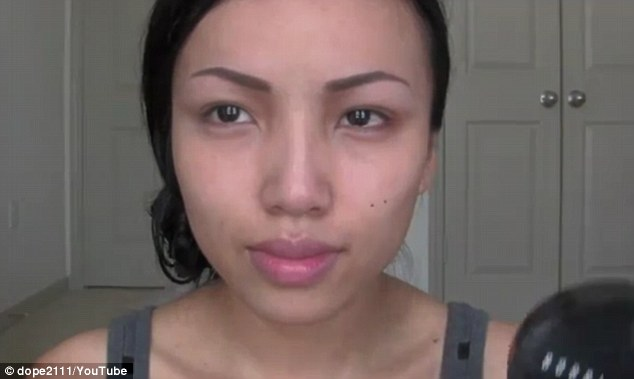 Bare-faced: Promise Tamang Phan prepares to transform herself in one of her dozens of popular YouTube make-up tutorials