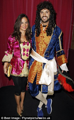 Party people: Pippa posed happily with the Vicomte de Soultrait (left) during the party thrown for her close French aristocrat friend