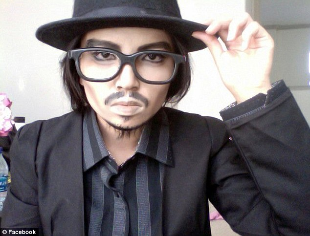 Tipping her hat: Retro specs and a fedora - and a little chin fuzz - finish off Promise's Johnny Depp look