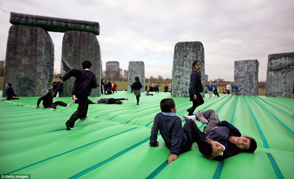 Children were walking on air today after Turner Prize-winning artist Jeremy Deller unveiled his life-size bouncy castle