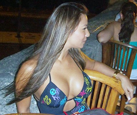 Controversy: Bikini-clad working girl Dania Suarez is at the centre of the Secret Service prostitution scandal
