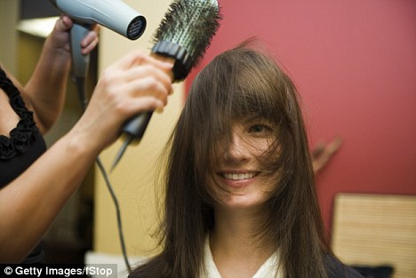 Happy: Nearly half of 1,056 British women aged 25 to 45 polled also said they get more of a buzz from getting their hair done than reaching for a chocolate treat