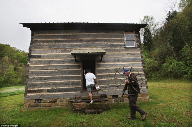 Volunteers help restore the Noble Pioneer Museum which contains artifacts of local Appalachian pioneer life
