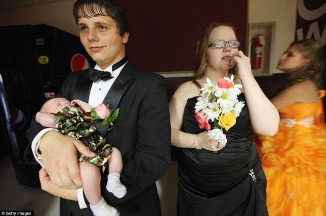 Married students Starr Lewis, second right, Travis Lewis and daughter Ariel Lewis, 3 weeks, attend the Owsley County High School prom on April 21