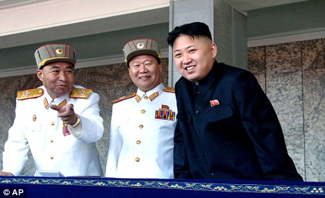Big guns: North Korean leader Kim Jong Un, right, with his military advisers