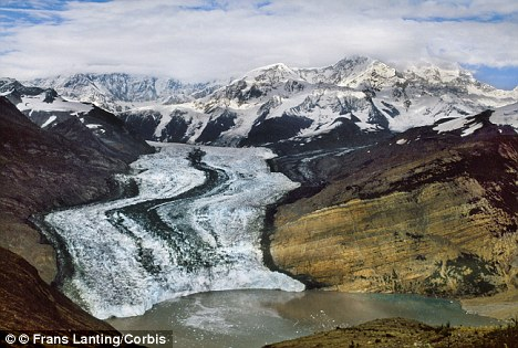 Global warming: A retreating glacier in Alaska USA. But despite alarmist theories, temperatures have barely risen in the past 20 years