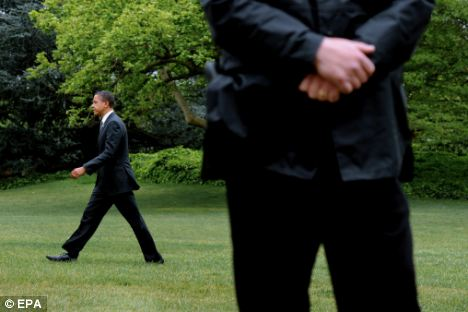 Embarrassment: U.S. President Barack Obama, pictured walking across the South Lawn of the White House, is now facing two scandals over the conduct of his staff abroad