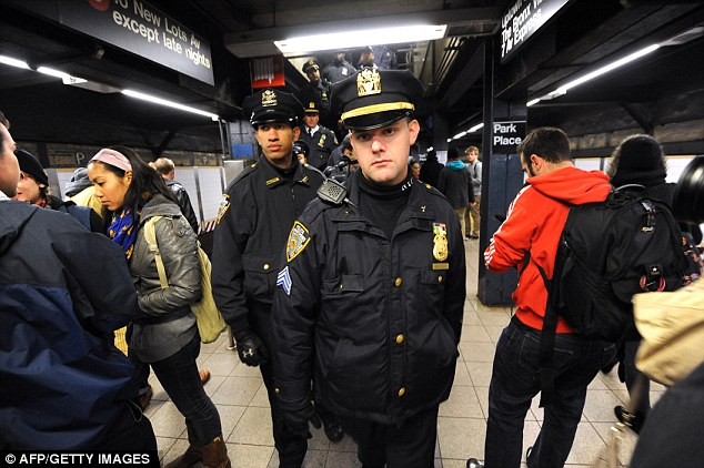 Patrolling: The Homeland Defence Secretary warned last week that a terrorist could target a train or subway, like those in New York (file photo)