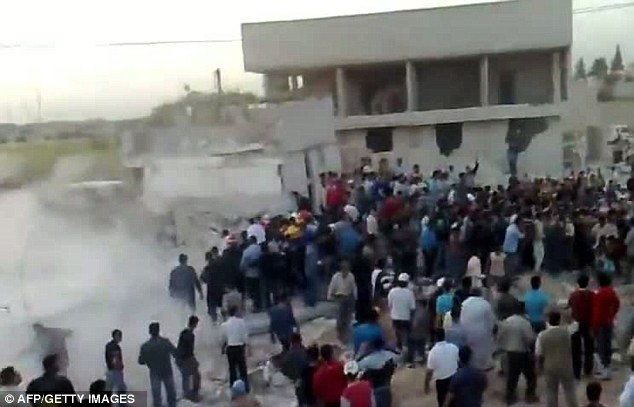 Grab taken from a video uploaded on YouTube allegedly showing people searching for survivors under the rubble of collapsed homes in Hama