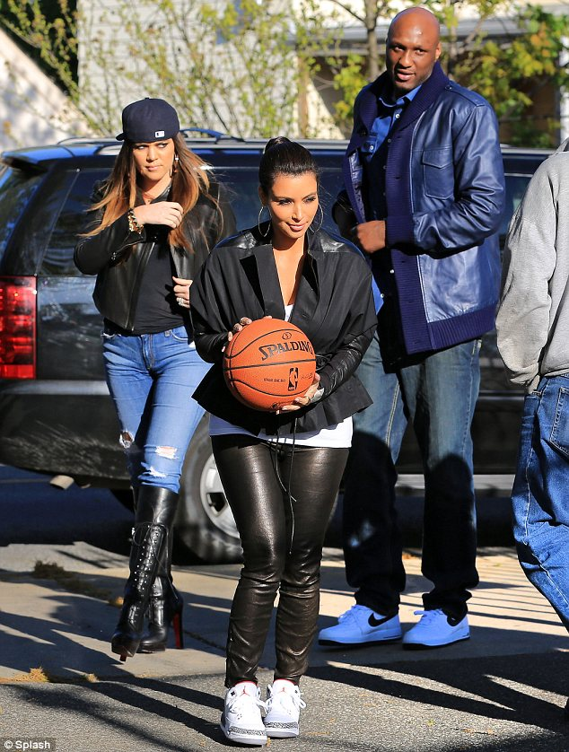 46c8ae43424 Courting attention  Khloe and Kim Kardashian donned unsuitable clothing for  a game of basketball in