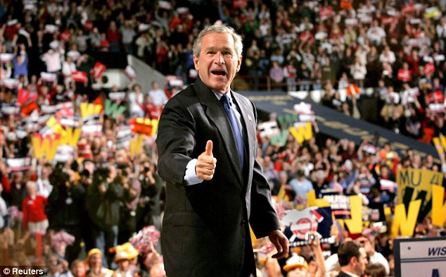 Predecessor: George W. Bush, pictured at a rally in Milwaukee, was a less active campaigner