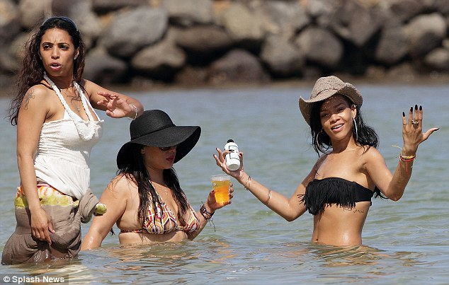 Join in the fun: The party of three seemed to be having a great time on their sunny break