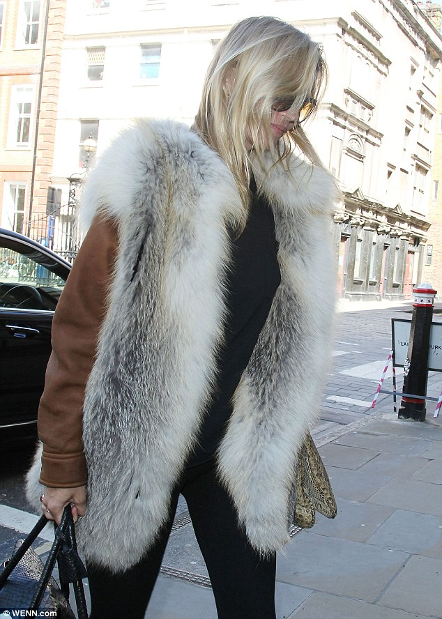 Kate Moss works the laid back look in fur and snakeskin as