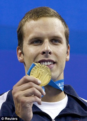Tragedy: Alexander Dale Oen with his gold medal after winning the men's 100m breaststroke at the World Championships in Shanghai