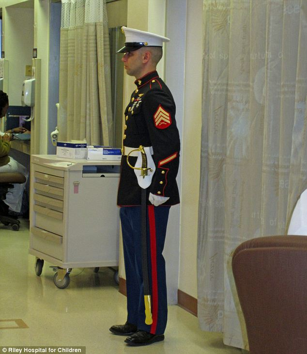 Honour guard: Mark Dolfini, 39, a local Marine, was so moved by Cody's story that he helped make the 12-year-old an honorary Marine before he passed on Saturday due to an infection related to cancer