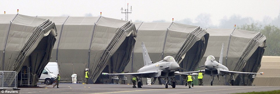 Lying in wait: Typhoon jets taxi to their hangars at the start of an exercise that will see them deployed alongside helicopters from the RAF and Royal Navy