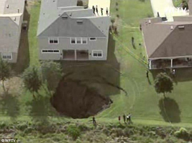 Wake-up call: The home owner said she noticed the sinkhole around 7am when she let the dog out