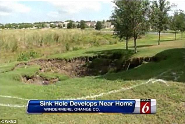 Gone in a second: The father told a local news station that the sinkhole spread rapidly and took several trees with it