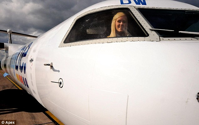 In the hot seat: Kate fell in love with planes as a nine-year-old and graduated in Aviation Technology from the University of Leeds. But after failing to find a job, she turned her attention to flying instead