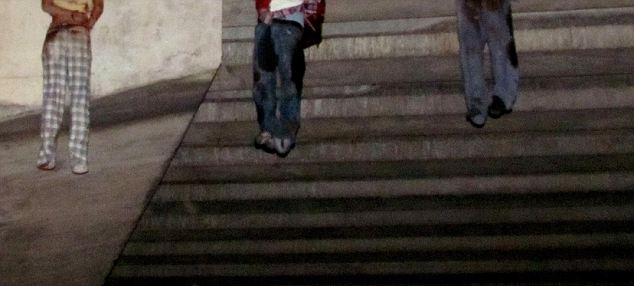 Drug war: The feet of four bodies are seen hanging from a bridge in the Mexican border city of Nuevo Laredo