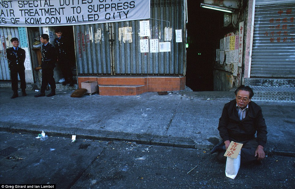 A Kowloon Walled City resident who is dissatisfied with compensation payouts from the government sits on a pavement in protest as police start the clearance operation