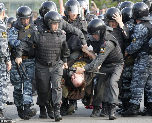 Disarray: Some demonstrators hurled stones at the police as throat-irritating gas wafted through the air