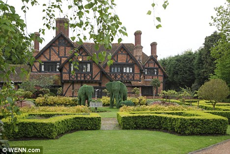 New digs: Brad and his fiancée Angelina Jolie are believed to have bought this house in Richmond, London, where they plan to live with their six children for the next three years