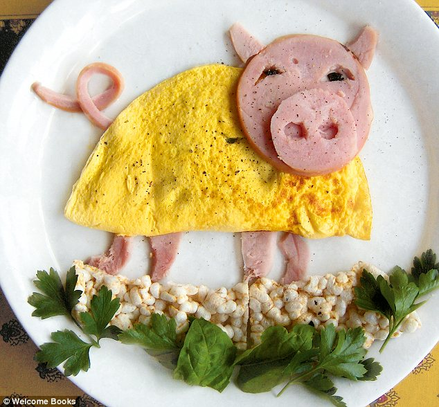 Playful: A ham-made pig sports a dress made from egg as he plays in a puddle of rice cakes and herbs